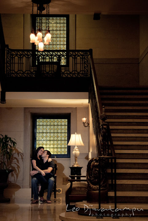 Engaged girl sits on her fiancé's lap. Tremont Plaza Hotel and Grand Historic Venue Baltimore Pre-wedding Engagement Photo Session by wedding photographers Leo Dj Photography