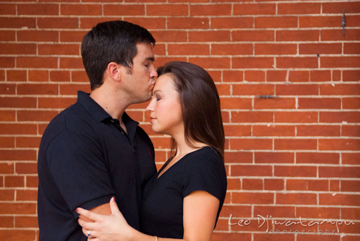 Engaged guy kissed his fiancée on the forehead. Tremont Plaza Hotel and Grand Historic Venue Baltimore Pre-wedding Engagement Photo Session by wedding photographers Leo Dj Photography
