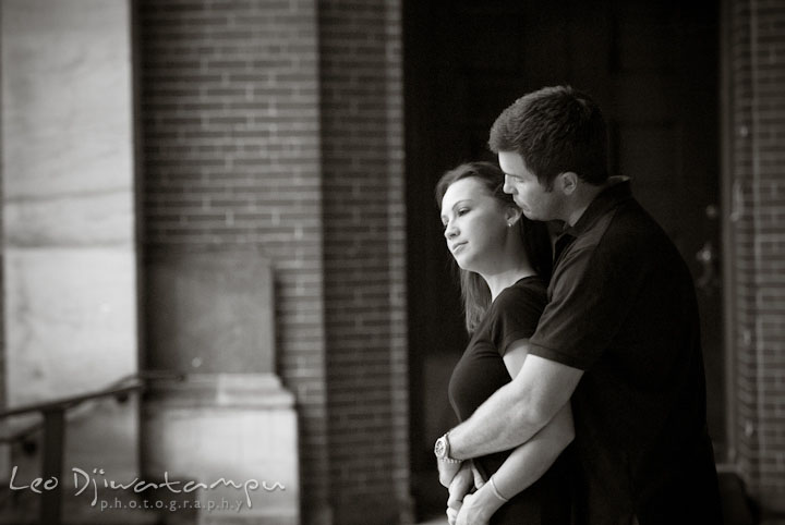 Engaged girl hugged by her fiancé. Tremont Plaza Hotel and Grand Historic Venue Baltimore Pre-wedding Engagement Photo Session by wedding photographers Leo Dj Photography