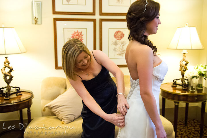 Mother of Bride helping buttoning up dress. Baltimore Maryland Tremont Plaza Hotel Grand Historic Venue wedding ceremony and reception photos, by photographers of Leo Dj Photography.