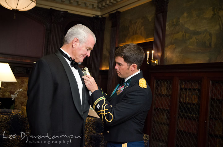 Groom help father put on boutonniere. Baltimore Maryland Tremont Plaza Hotel Grand Historic Venue wedding ceremony and reception photos, by photographers of Leo Dj Photography.