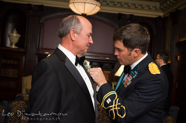Groom help Father of Bride put on boutonniere. Baltimore Maryland Tremont Plaza Hotel Grand Historic Venue wedding ceremony and reception photos, by photographers of Leo Dj Photography.