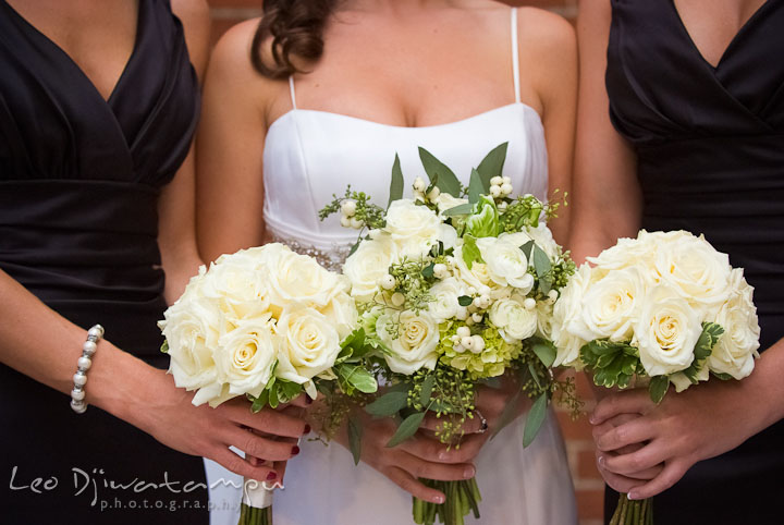 Bride, Maid of Honor, and bridesmaid showing white rose flower bouquets. Baltimore Maryland Tremont Plaza Hotel Grand Historic Venue wedding ceremony and reception photos, by photographers of Leo Dj Photography.