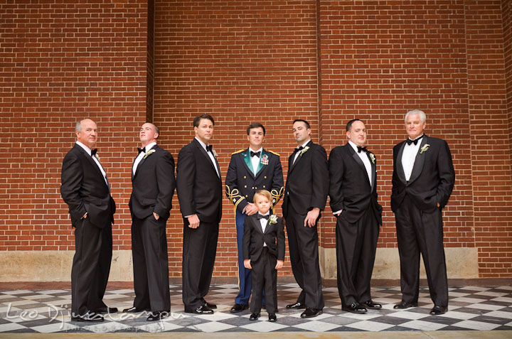 Groom, Best Man, groomsmen, Father of the Bride and Father of the Groom posing. Baltimore Maryland Tremont Plaza Hotel Grand Historic Venue wedding ceremony and reception photos, by photographers of Leo Dj Photography.