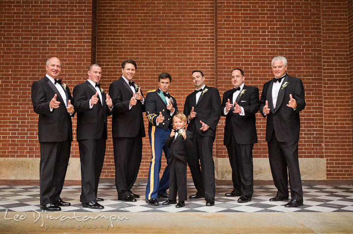 Groom, Best Man, groomsmen, Father of the Bride and Father of the Groom doing funny pose. Baltimore Maryland Tremont Plaza Hotel Grand Historic Venue wedding ceremony and reception photos, by photographers of Leo Dj Photography.
