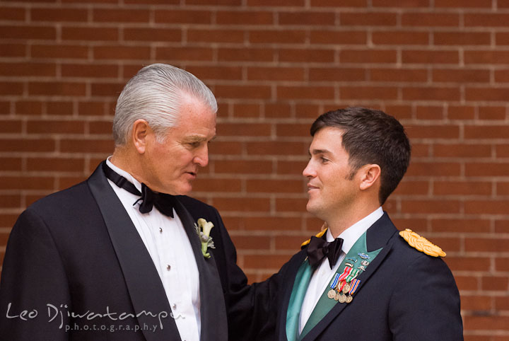 Father of Groom giving words of advice to son before walking down the isle. Baltimore Maryland Tremont Plaza Hotel Grand Historic Venue wedding ceremony and reception photos, by photographers of Leo Dj Photography.