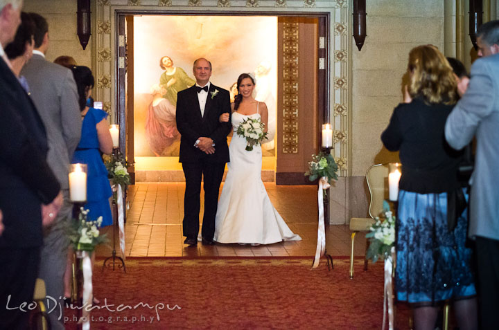 Father of the Bride escorting daughter walking down the isle. Baltimore Maryland Tremont Plaza Hotel Grand Historic Venue wedding ceremony and reception photos, by photographers of Leo Dj Photography.
