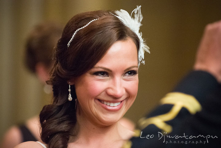 Bride smile while reading her wedding vow to groom. Baltimore Maryland Tremont Plaza Hotel Grand Historic Venue wedding ceremony and reception photos, by photographers of Leo Dj Photography.