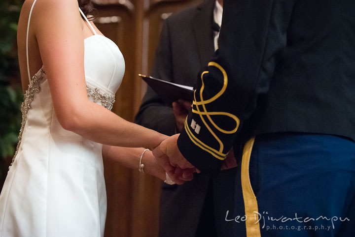 Bride and groom holding hands during ceremony. Baltimore Maryland Tremont Plaza Hotel Grand Historic Venue wedding ceremony and reception photos, by photographers of Leo Dj Photography.