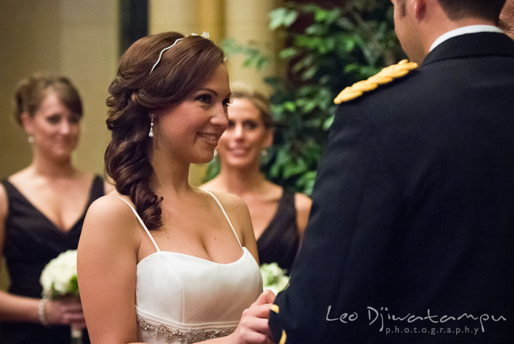 Bride smile while putting wedding ring on Groom. Baltimore Maryland Tremont Plaza Hotel Grand Historic Venue wedding ceremony and reception photos, by photographers of Leo Dj Photography.