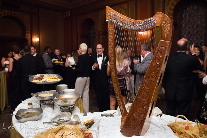 Small harp decoration in Oriental Room during cocktail hour. Baltimore Maryland Tremont Plaza Hotel Grand Historic Venue wedding ceremony and reception photos, by photographers of Leo Dj Photography.