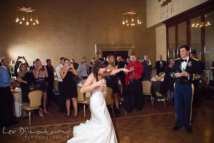 Bride and groom after being introduced by the DJ. Baltimore Maryland Tremont Plaza Hotel Grand Historic Venue wedding ceremony and reception photos, by photographers of Leo Dj Photography.