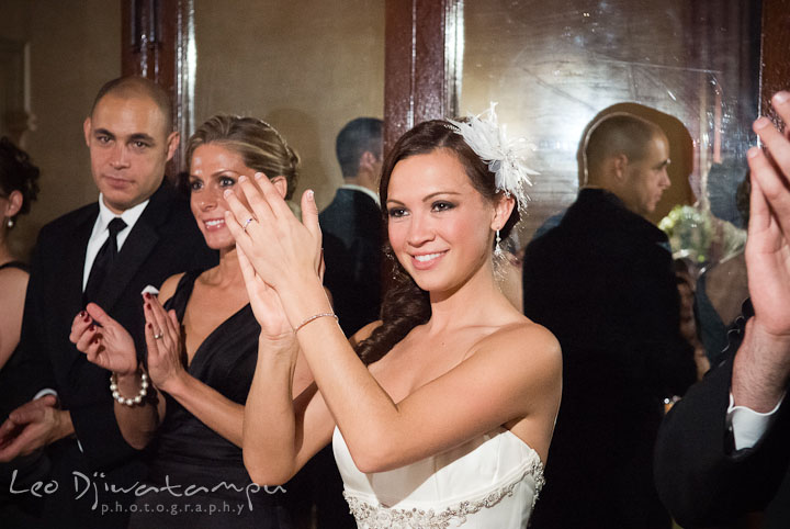 Bride clapping hands. Baltimore Maryland Tremont Plaza Hotel Grand Historic Venue wedding ceremony and reception photos, by photographers of Leo Dj Photography.