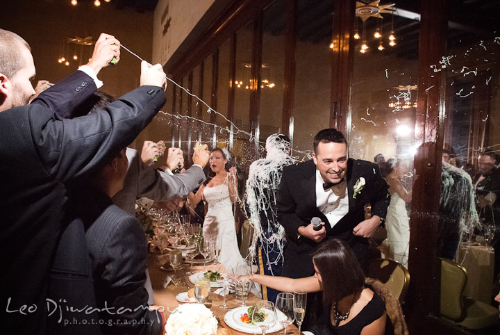 Guest pranked groom with silly strings. Baltimore Maryland Tremont Plaza Hotel Grand Historic Venue wedding ceremony and reception photos, by photographers of Leo Dj Photography.