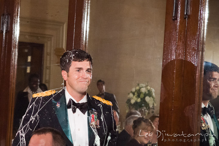 Groom after the silly string aftermath. Baltimore Maryland Tremont Plaza Hotel Grand Historic Venue wedding ceremony and reception photos, by photographers of Leo Dj Photography.