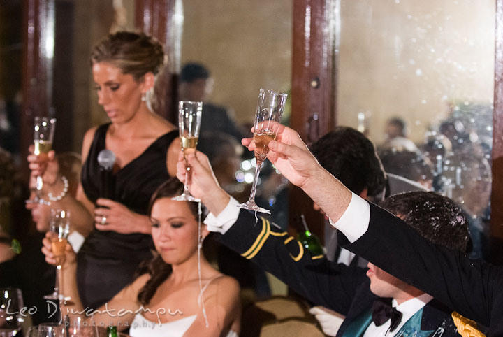 Bride groom and guests raised champagne glass. Baltimore Maryland Tremont Plaza Hotel Grand Historic Venue wedding ceremony and reception photos, by photographers of Leo Dj Photography.