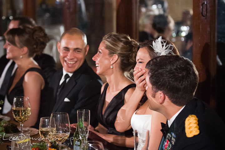 Bride and wedding party laughing during speech. Baltimore Maryland Tremont Plaza Hotel Grand Historic Venue wedding ceremony and reception photos, by photographers of Leo Dj Photography.