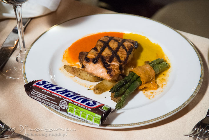 Salmon steak main course plate with snickers. Baltimore Maryland Tremont Plaza Hotel Grand Historic Venue wedding ceremony and reception photos, by photographers of Leo Dj Photography.