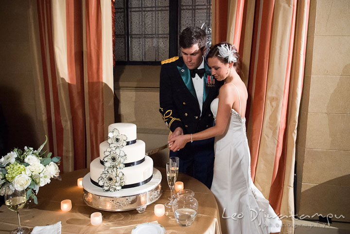 Bride and Groom cutting cake. Baltimore Maryland Tremont Plaza Hotel Grand Historic Venue wedding ceremony and reception photos, by photographers of Leo Dj Photography.