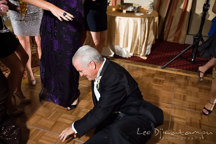 Father of the Groom dancing on the floor. Baltimore Maryland Tremont Plaza Hotel Grand Historic Venue wedding ceremony and reception photos, by photographers of Leo Dj Photography.