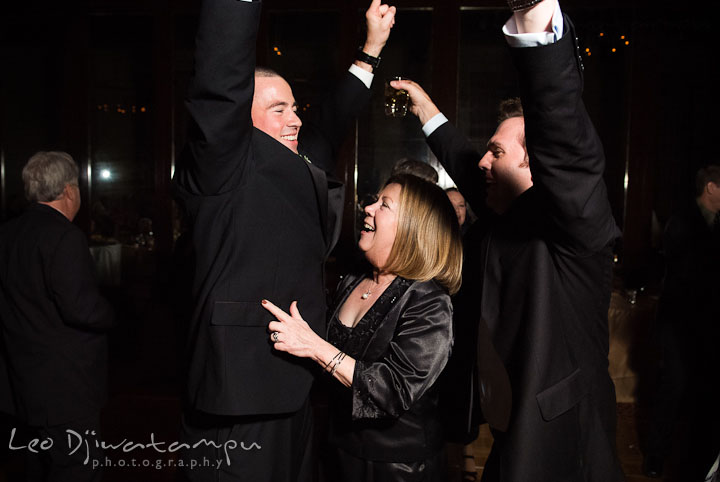 Mother of the Bride dancing with two guys. Baltimore Maryland Tremont Plaza Hotel Grand Historic Venue wedding ceremony and reception photos, by photographers of Leo Dj Photography.