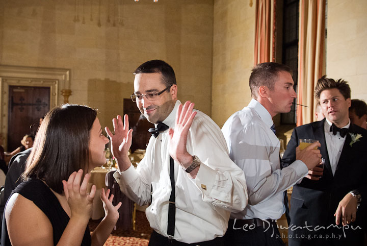 Best Man dancing with his wife. Baltimore Maryland Tremont Plaza Hotel Grand Historic Venue wedding ceremony and reception photos, by photographers of Leo Dj Photography.
