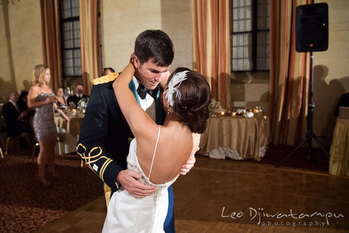 Bride put arms around Groom's neck while dancing. Baltimore Maryland Tremont Plaza Hotel Grand Historic Venue wedding ceremony and reception photos, by photographers of Leo Dj Photography.