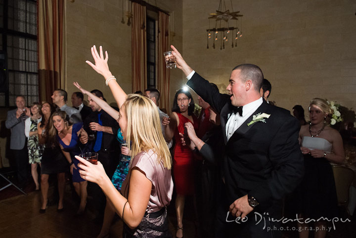 Guests cheering Bride and Groom dancing. Baltimore Maryland Tremont Plaza Hotel Grand Historic Venue wedding ceremony and reception photos, by photographers of Leo Dj Photography.