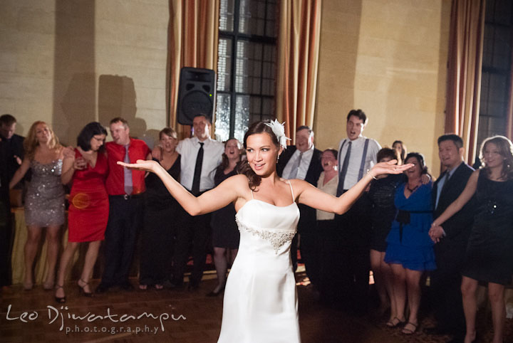 Bride singing and spreading out arms. Baltimore Maryland Tremont Plaza Hotel Grand Historic Venue wedding ceremony and reception photos, by photographers of Leo Dj Photography.