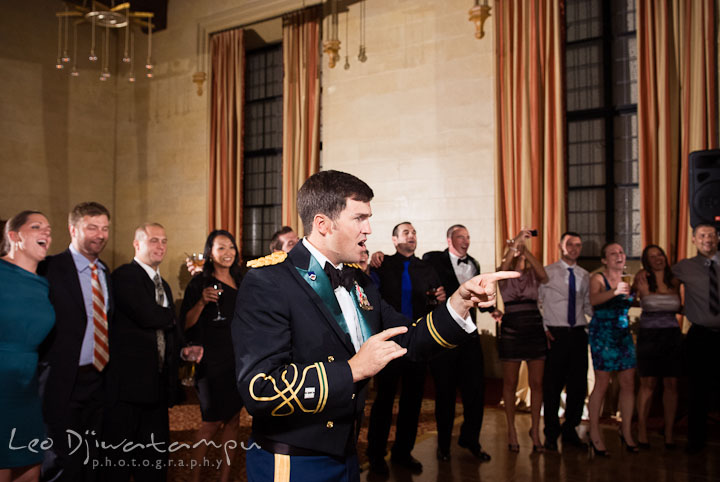 Groom singing and poiting to Bride. Baltimore Maryland Tremont Plaza Hotel Grand Historic Venue wedding ceremony and reception photos, by photographers of Leo Dj Photography.