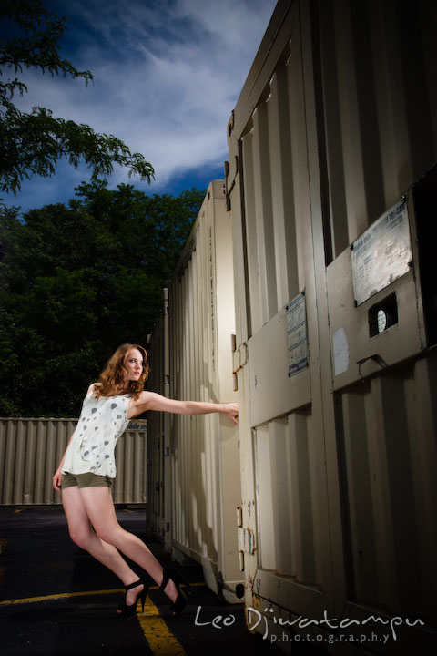 Girl model holding trailer storage containers. Lighting Essentials Workshops - Baltimore with Don Giannatti
