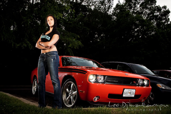 Girl model posing with an orange Dodge Challenger sport car for a hip-hop theme for a magazine spread. Lighting Essentials Workshops - Baltimore with Don Giannatti
