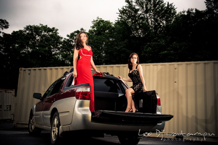Two beautiful model girls posing on a pickup truck. Lighting Essentials Workshops - Baltimore with Don Giannatti