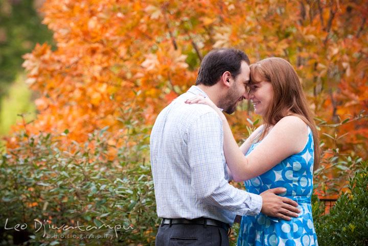 An engaged couple cuddling. Washington DC National Zoo pre-wedding engagement session by Leo Dj Photography