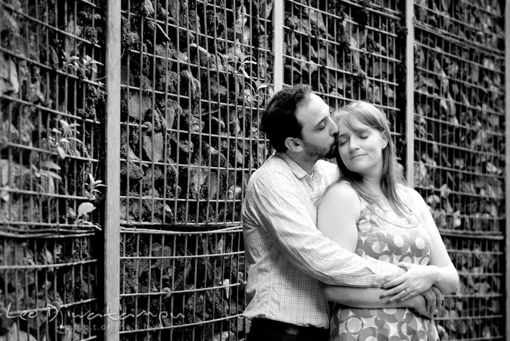 Engaged girl cuddled by her fiancé. Washington DC National Zoo pre-wedding engagement session by Leo Dj Photography