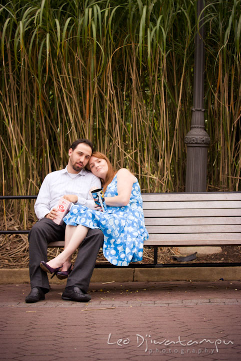Engaged guy and girl sitting on a bench. Washington DC National Zoo pre-wedding engagement session by Leo Dj Photography