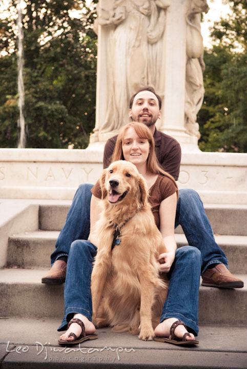Engaged girl posing with her dog and fiancé. Dupont Circle Washington DC pre-wedding engagement session by Leo Dj Photography