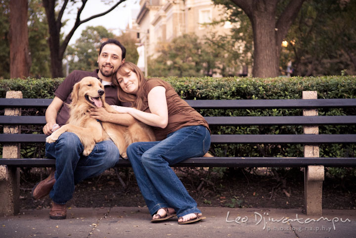 Engaged couple and their golden retriever posing on a bench. Dupont Circle Washington DC pre-wedding engagement session by Leo Dj Photography