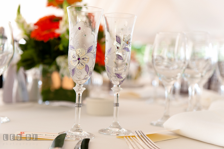 Custom made champagne glasses with floral decorations. Historic London Town and Gardens wedding photos at Edgewater Annapolis, Maryland by photographers of Leo Dj Photography. http://leodjphoto.com