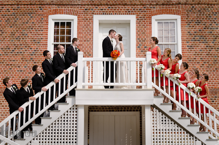 Groom party and Bridal party looking at Bride and Groom kissing. Historic London Town and Gardens wedding photos at Edgewater Annapolis, Maryland by photographers of Leo Dj Photography. http://leodjphoto.com