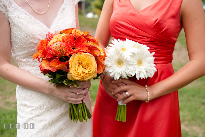 Bride and Matron of honor holding their beautiful floral bouquets. Historic London Town and Gardens wedding photos at Edgewater Annapolis, Maryland by photographers of Leo Dj Photography. http://leodjphoto.com
