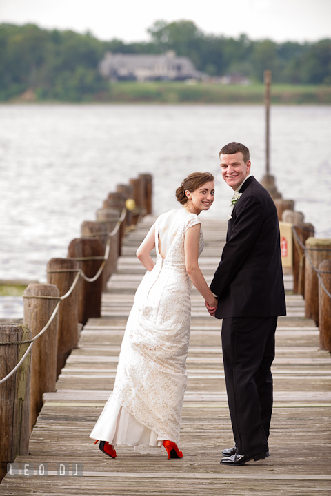 Bride and Groom holding hands at the pier. Historic London Town and Gardens wedding photos at Edgewater Annapolis, Maryland by photographers of Leo Dj Photography. http://leodjphoto.com