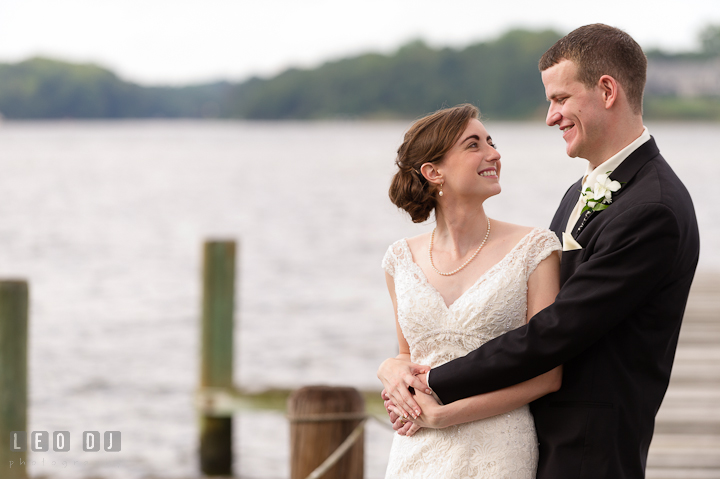Bride and Groom cuddling and smiling. Historic London Town and Gardens wedding photos at Edgewater Annapolis, Maryland by photographers of Leo Dj Photography. http://leodjphoto.com
