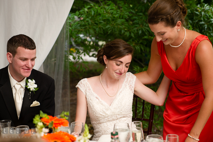 Bride emotional after listening to Matron of Honor's speech. Historic London Town and Gardens wedding photos at Edgewater Annapolis, Maryland by photographers of Leo Dj Photography. http://leodjphoto.com