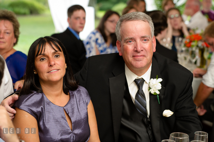 Father of the Bride smiling listening to Best Man's speech. Historic London Town and Gardens wedding photos at Edgewater Annapolis, Maryland by photographers of Leo Dj Photography. http://leodjphoto.com
