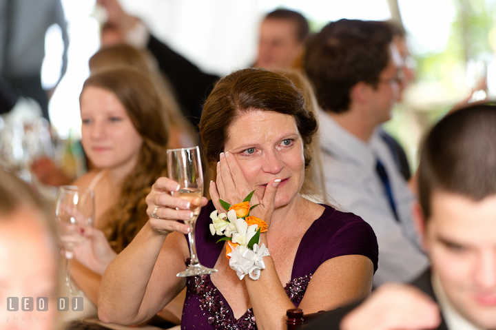 Mother of Groom shed tear listening to Father of Bride's speech. Historic London Town and Gardens wedding photos at Edgewater Annapolis, Maryland by photographers of Leo Dj Photography. http://leodjphoto.com