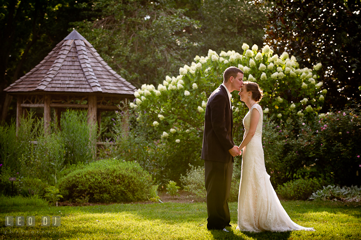 Bride and Groom kissed by the gazebo. Historic London Town and Gardens wedding photos at Edgewater Annapolis, Maryland by photographers of Leo Dj Photography. http://leodjphoto.com
