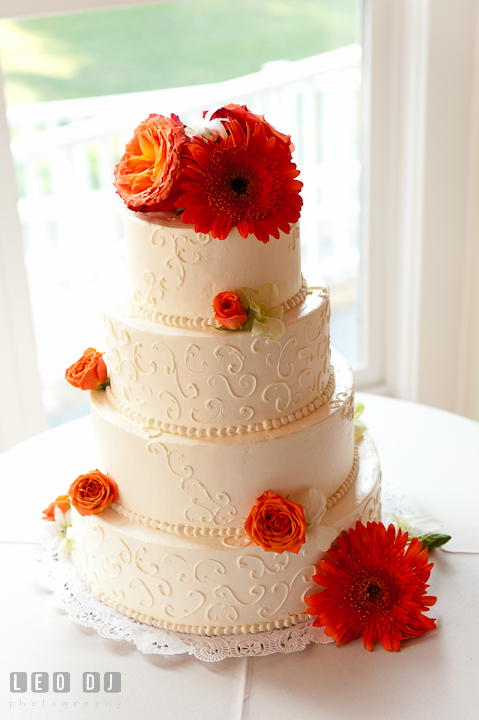 Beautiful cake from Fiona's Cakes decorated with orange flowers. Historic London Town and Gardens wedding photos at Edgewater Annapolis, Maryland by photographers of Leo Dj Photography. http://leodjphoto.com