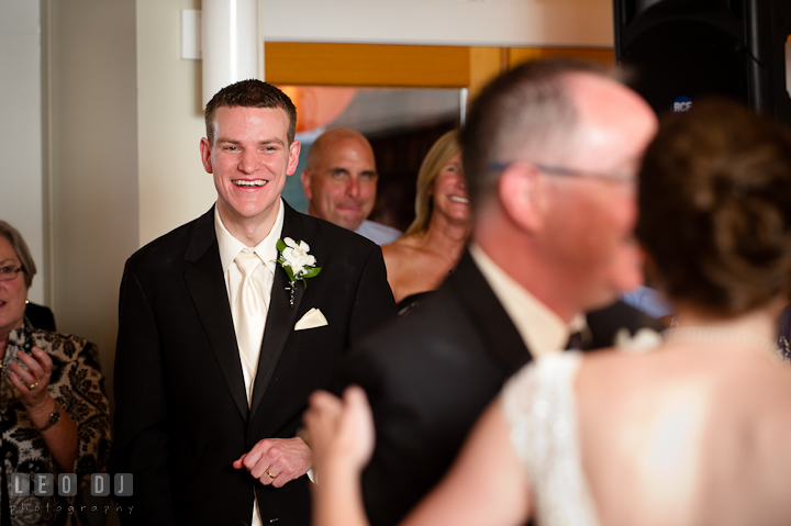 Groom laughing seeing the Father Daughter dance. Historic London Town and Gardens wedding photos at Edgewater Annapolis, Maryland by photographers of Leo Dj Photography. http://leodjphoto.com