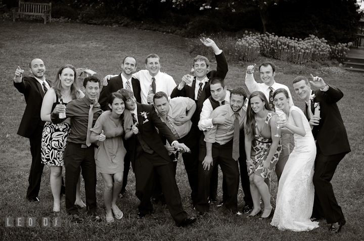 Bride and Groom posing for group shot with college alumni. Historic London Town and Gardens wedding photos at Edgewater Annapolis, Maryland by photographers of Leo Dj Photography. http://leodjphoto.com